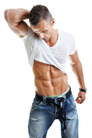 six pack abs: Powerful muscular man posing on a white background Stock Photo