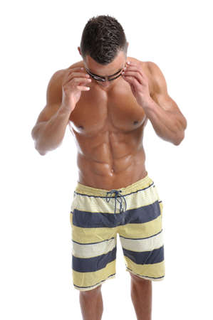 torsos: Powerful muscular man posing on a white background Stock Photo