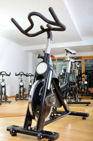 Group of spinning bicycles at fitness studio photo