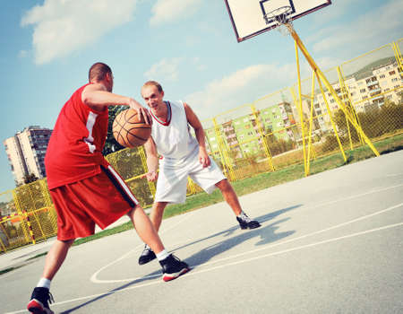 basketball team: Two basketball players on the court Stock Photo