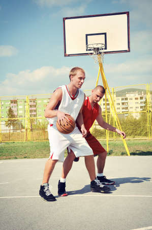 Two basketball players on the court Imagens