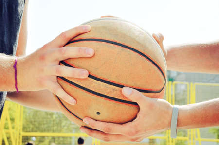 fairplay: Basketball players holding the ball. Fairplay concept.
