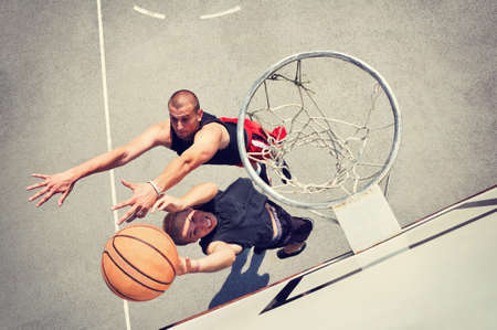 outdoor basketball court: Two basketball players on the court Stock Photo