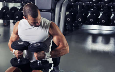 body torso: Handsome Muscular Male Model Posing With Dumbbells