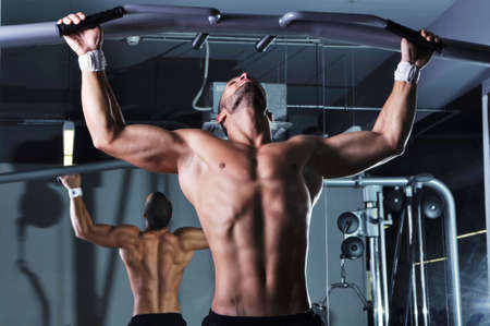 ups: Handsome Muscular Male Model With Perfect Body Doing Pull Ups Stock Photo