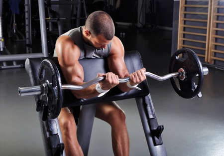 Handsome Muscular Male Model With Perfect Body Doing Biceps Exercise