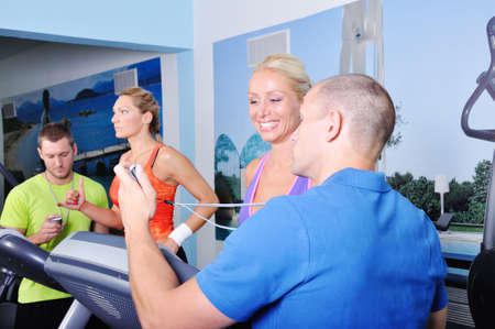 Personal fitness trainer showing result to a client photo