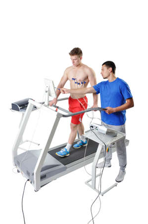 Sports Scientist doing Performance Assessment on Treadmill. Modern Technology. Banque d'images