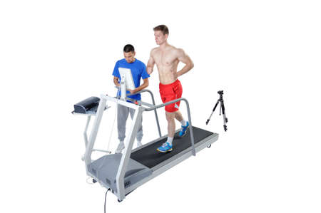Sports Scientist doing Performance Assessment with Treadmill and High Speed Camera. Modern Technology. Banque d'images