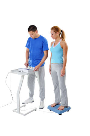 Sports Scientist doing Balance Assessment with Professional Equipment. Modern Technology. Stock Photo