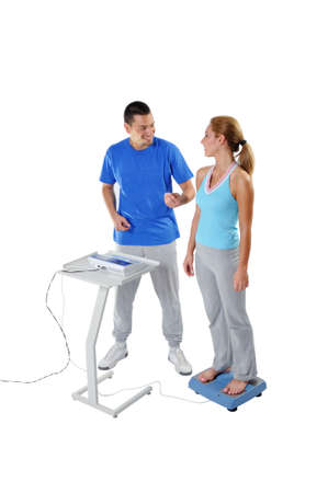 Sports Scientist doing Balance Assessment with Professional Equipment. Modern Technology. Banque d'images