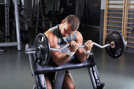man power: Handsome Muscular Male Model With Perfect Body Doing Biceps Exercise