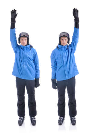 interchangeably: Skiier demonstrate warm up exercise for skiing. Interchangeably hands up and down.