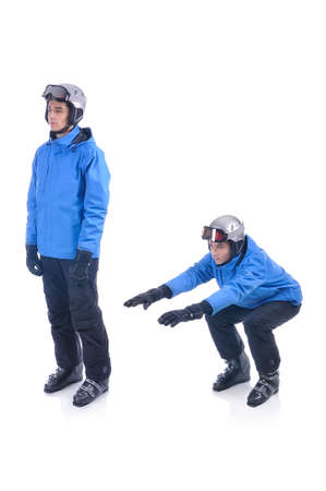warm up exercise: Skiier demonstrate warm up exercise for skiing. The squats. Stock Photo