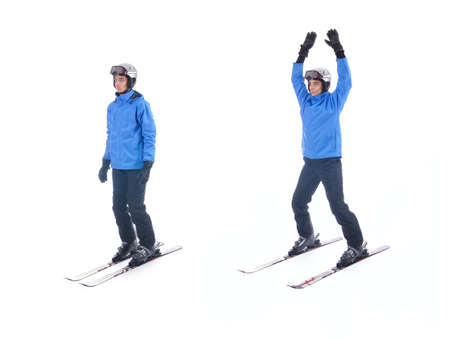 jacks: Skiier demonstrate warm up exercise for skiing. Jumping Jacks with skis.