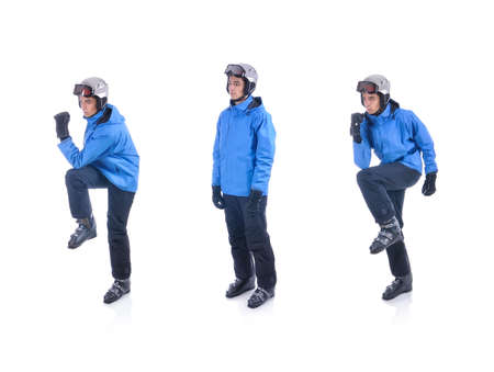 warm up exercise: Skiier demonstrate warm up exercise for skiing. The opposite elbow-knee touch. Stock Photo