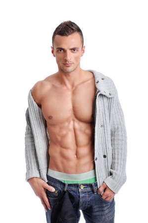 sixpack: Portrait of Powerful Muscular Man Posing on a White Background