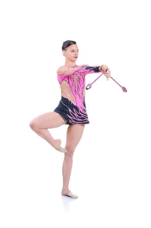 acrobacia: Beautiful artistic female gymnast working out, performing art gymnastics element