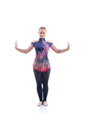 female gymnast: Beautiful artistic female gymnast working out, performing art gymnastics element