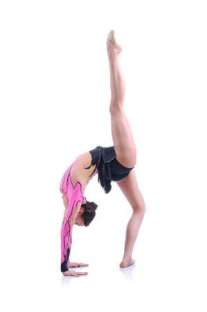an entertainer: Beautiful artistic female gymnast working out, performing art gymnastics element