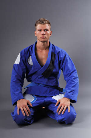 Portrait of Handsome Muscular Jiu Jitsu Fighter Posing. Concept of Healthy Lifestyle