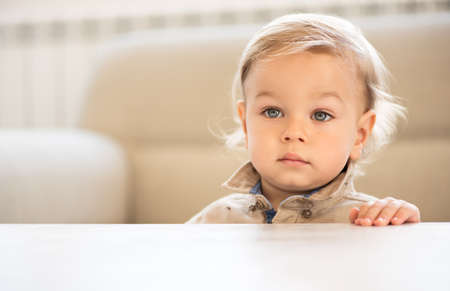 Portrait of little boy with blue eyes.