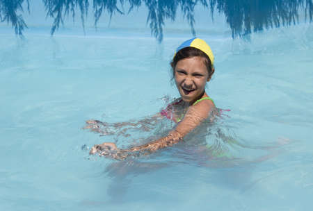 young girl swims play in pool photo