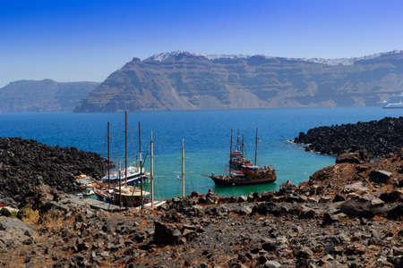 Greece Thirassia boat santorini nea Kameni volcano caldera Stock Photo