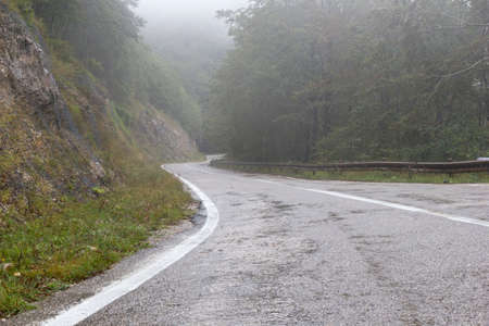 mountain road with fog and rain Stock Photo