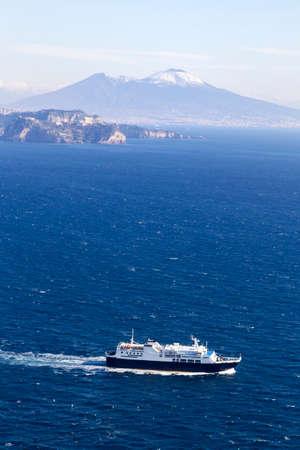 ship in gulf of naples and vesuvio in background