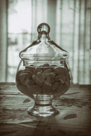 comfit in glass container vintage photo Stock Photo