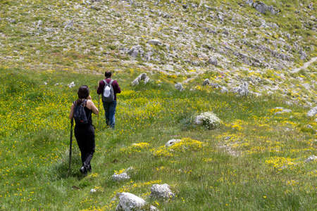 man and woman hikers on mountain