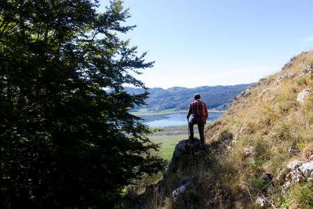 hiker on mountain peak and lake matese