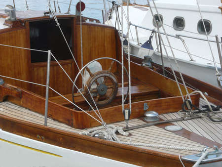 helm of classic wooden sailboat Stock Photo