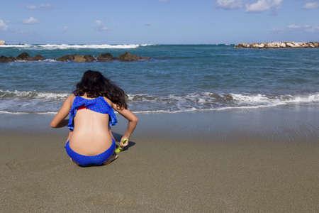 girls play on beach chiaia forio ischia Stock Photo