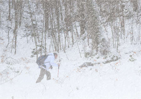 hiker in snowstorm in mountain trail Foto de archivo