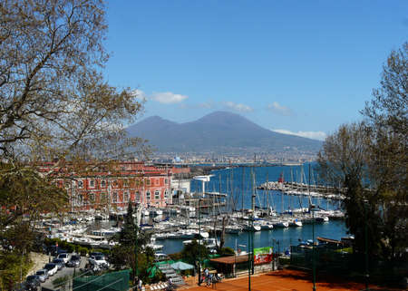 view of naples with boats and vesuvius