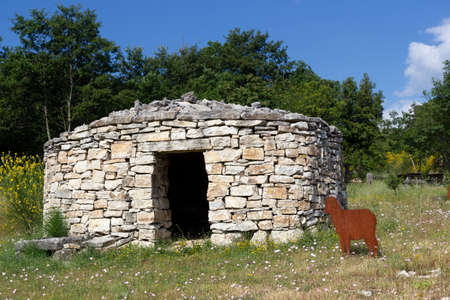 reconstruction of ancient sheepfold and fake sheep in Morcone