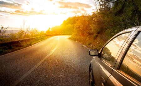 car at sunset on mountain street Standard-Bild