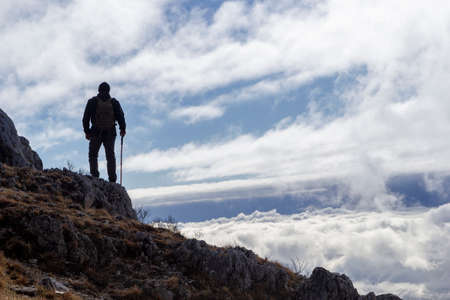 hiker on the top of a mountain
