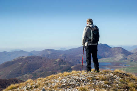 hiker in the mountains with lake in matese park