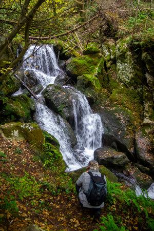 hiker take photo on wonderful waterfalls of the cypress forest of fontegreca Stock Photo
