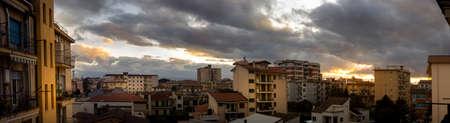 city skyline with sunset clouds of Aversa Stock Photo