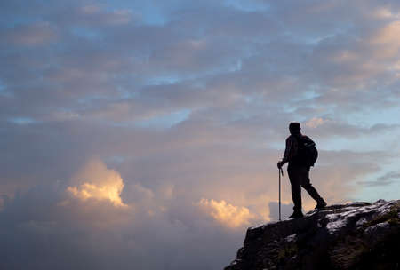 hiker on the top of a mountain in matese park in the clouds
