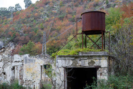 old water tank on ruined house
