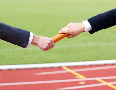 Business People Passing Relay Baton