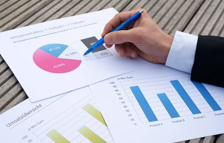 Close up of Businessman's hand examining business charts