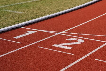 Stadium and running track one and two start finish Imagens