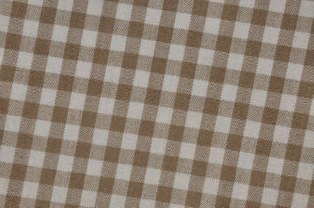 Beige tablecloth grid, checkerboard pattern photo
