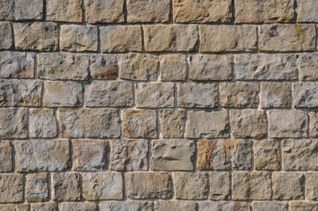 De muur van zandsteen blokken